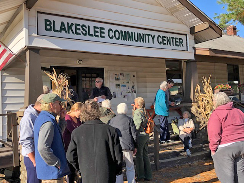Ceremony attendees gather at the Blakeslee Community Center in the warm fall sun.