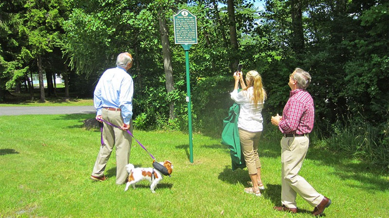 Admiring the marker, from left, are Dr. James Kitchen III, Emiline Kitchen-Diener and Dr. Ian Diener.