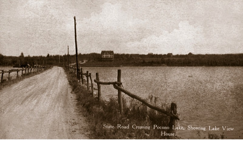 State Route 940 as it crosses Pocono Lake, facing east. The Lake View House can be seen on the eastern shore. The ice house was a few hundred yards further south (right), out of view.