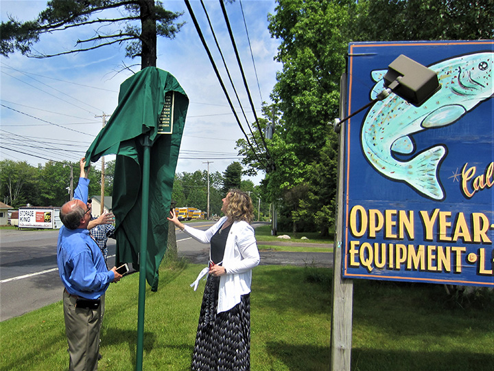 Pulling the veil off the First Schoolhouse historical marker.