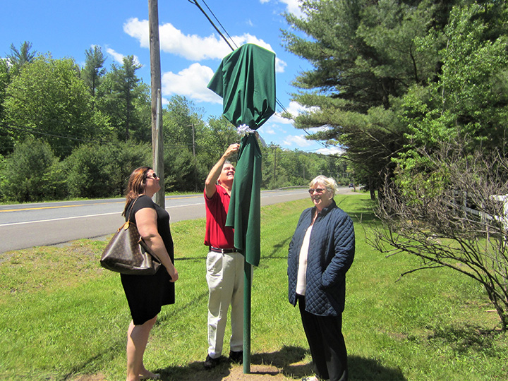 Sarah, Bruce and Trudi Denlinger unveil the Wilkes-Barre & Eastern Railroad marker on June 3, 2017..
